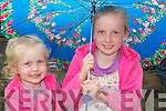 SISTERS: Lorna and Aoife Larkin from Templeglantine.take shelter from a downpour on Saturday evening at the.motorcycle races in Athea.