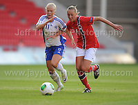 Adelina Engman of Finland battles with Carlotta Fennefoss of Norway during the UEFA Womens U19 Championships at Parc y Scarlets, Monday 19th August 2013. All images are the copyright of Jeff Thomas Photography-www.jaypics.photoshelter.com-07837 386244-Any use of images must be authorised by the copyright owner.