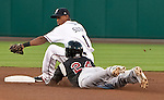 Reno Aces shortstop Wladimir Sutil tags out Sacramento River Cats Jermaine Mitchell as he trys to take an extra base on a single during their play off game on Saturday night September 8, 2012 at Aces Ballpark in Reno NV.
