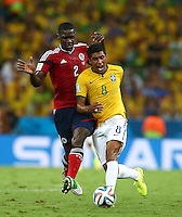 Cristian Zapata of Colombia and Paulinho of Brazil in action