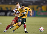 FC Dallas's Greg Vanney tries to defend Los Angeles Galaxy's Hercules Gomez at the US Open Cup, in the first half at the Home Depot Center, in Carson, Calif., Wednesday, September 28, 2005.