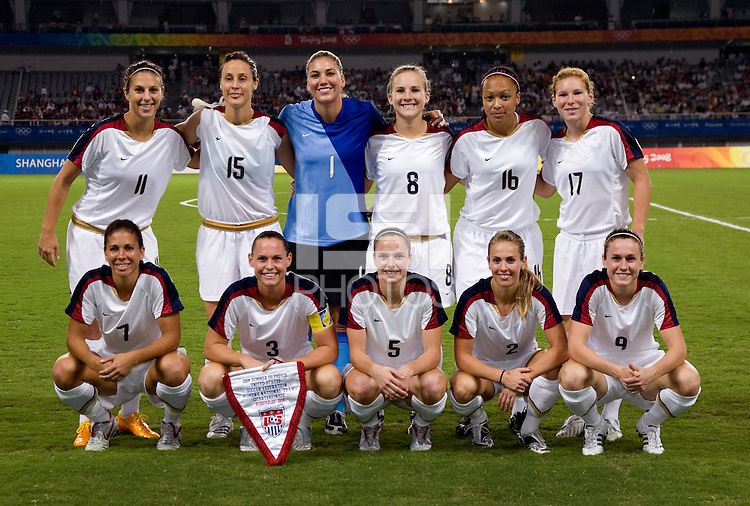 The USWNT lines up before playing at Shanghai Stadium.  The US defeated Canada, 2-1, in extra time and advanced to the semifinals during the 2008 Beijing Olympics in Shanghai, China.