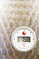 The winery with modern stainless steel fermentation tanks. Detail of thermometer showing 15 degrees centigrade, with condensation water drips. Letina make. Toreta Vinarija Winery in Smokvica village on Korcula island. Vinarija Toreta Winery, Smokvica town. Peljesac peninsula. Dalmatian Coast, Croatia, Europe.