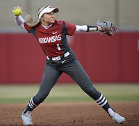NWA Democrat-Gazette/ANDY SHUPE<br /> Arkansas shortstop Maggie Hicks prepares to throw to first for an out against Southeast Missouri Thursday, Feb. 21, 2019, during the third inning at Bogle Park on the university campus in Fayetteville.