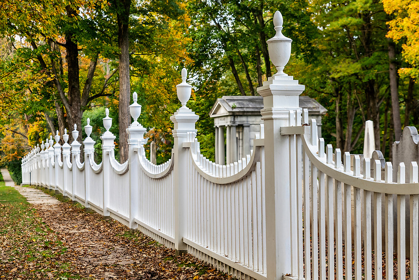 Charming New England picket fence with autumn foliage, Bennington, Vermont, USA.