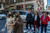 NEW YORK, NEW YORK - MARCH 4:  Woman wear face mask as people walk through Times Square on March 4, 2020 in New York City. The coronavirus cases in New York has been doubled to 22. Eight new victims testing positive state wide Gov. Cuomo announced Thursday.. (Photo by Pablo Monsalve / VIEWpress)
