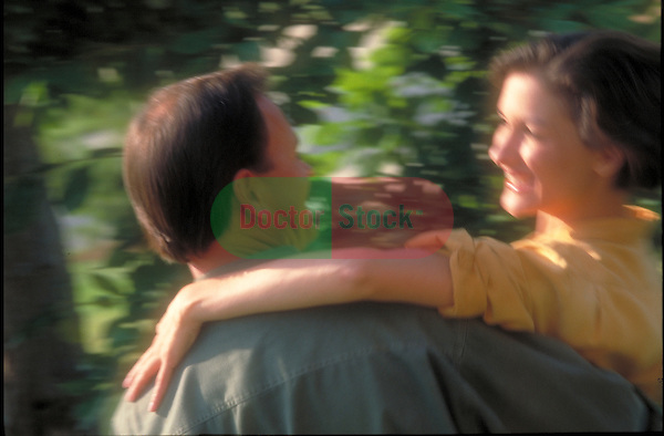 blurred image of man carrying woman, young, happy, healthy couple