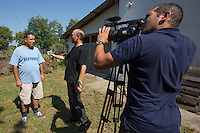 CNC TV crew records an interview with a local man about illegal migration near Roszke (about 174 km South of capital city Budapest), Hungary on August 30, 2015. ATTILA VOLGYI
