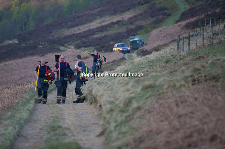 10/05/16 <br /> <br /> Fire crews fight a fire high up in a remote part of the Peak District between Sheffield and Manchester, on heather moorland that was destroyed today after a BBQ started a fire in the valley below.<br /> <br /> Full story:   http://www.fstoppress.com/articles/peak-district-fire/<br /> <br /> .A small group of gamekeepers spent the night fighting a major blaze blaze covering two hundred acres of heather moorland close to the Derwent and Ladybower reservoirs in the Derbyshire Peak District.<br /> <br /> The fire, which broke out at around 1pm on Monday, is believed to have been started by a disposable barbecue, according to a spokesman for the reservoir, which quickly escalated into a major fire threatening the natural habitat of many wild animals and birds including red grouse, plovers, meadow pipits and hen harriers.<br /> <br /> Ten fire crews were called to tackle the flames, and remained on scene until dusk fell, leaving the job of managing the fire overnight to the gamekeepers on scene.<br /> <br /> Kieran Logan was one of the gamekeepers left battling the flames and he said moorland management policies implemented some 10 years ago by the landowners, The National Trust were also partly to blame.<br /> <br /> All Rights Reserved: F Stop Press Ltd. +44(0)1335 418365   +44 (0)7765 242650 www.fstoppress.com