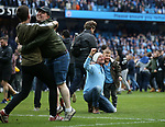 Manchester City fans pose for pictures as they invade the pitch during the premier league match at the Etihad Stadium, Manchester. Picture date 22nd April 2018. Picture credit should read: Simon Bellis/Sportimage