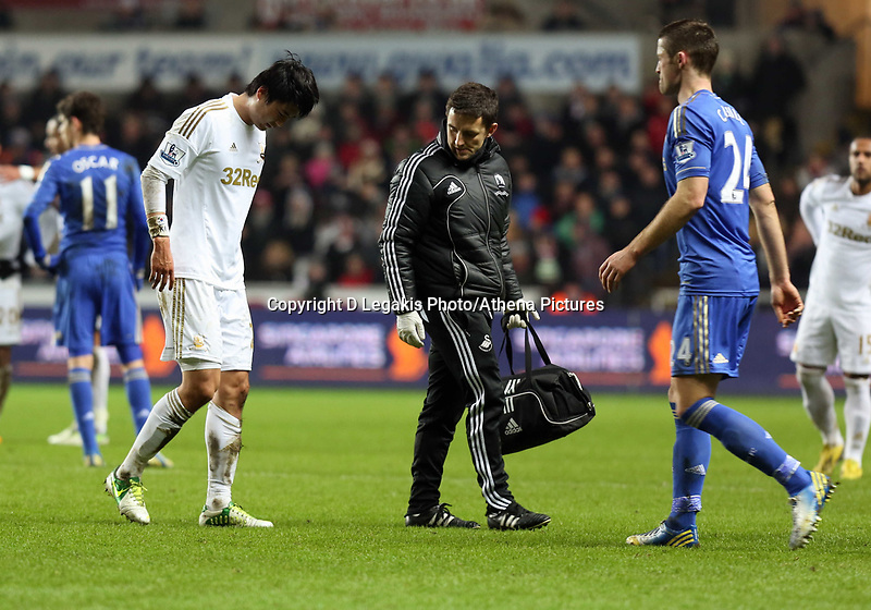 Wednesday 23 January 2013<br /> Pictured: Ki Sung Yueng of Swansea (L) is limping off pitch after getting injured<br /> Re: Capital One Cup semi-final second leg, Swansea City FC v Chelsea at the Liberty Stadium, south Wales.