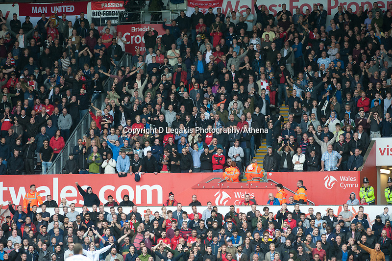 Saturday 17 August 2013<br /> <br /> Pictured: Manchester United fans<br /> <br /> Re: Barclays Premier League Swansea City v Manchester United at the Liberty Stadium, Swansea, Wales