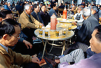China. Shanghai. Downtown. City center. Fuxing Park. Fuxing means revival. Early morning a group of old chinese men drink tea and talk together.  © 2002 Didier Ruef