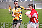 Asdee V Kilgarvan: Kilgarvan's Con Godfrey wins possesion of the ball despite the close attention of Asdee's Kieran Kelly.