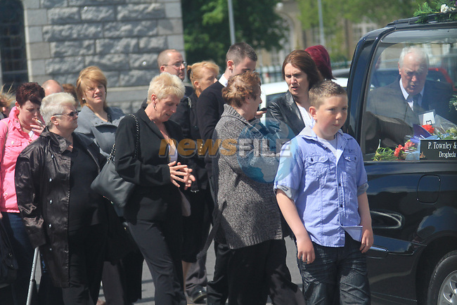 The Funeral of Alicia Krings who was found dead in the front room of her house in Termon Abbey last Tuesday. It is believed Alicia Krings had died some days before her body was found. The funeral of her daughter Susan Krings, 34 is due to take place during the week after she was killed in the house fire early on Saturday Morning..Pictures shows second daughter standing behind young boy..Picture: Fran Caffrey / www.newsfile.ie.