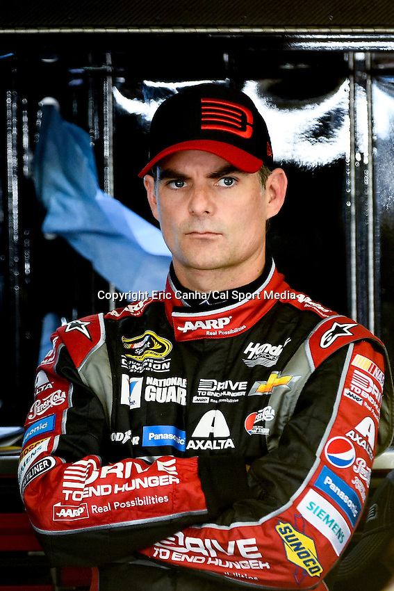 September 19, 2014 - Loudon, New Hampshire, U.S. -  Sprint Cup Series driver Jeff Gordon (24) waits for adjustments to be made to his car during a practice session of the NASCAR Sprint Cup Series Sylvania 300 held at the New Hampshire Motor Speedway in Loudon, New Hampshire.   Eric Canha/CSM