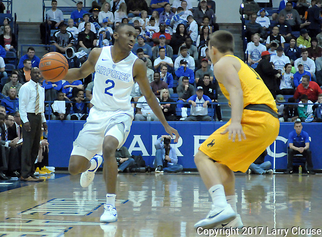 February 4, 2017:  Air Force guard, CJ Siples #2, brings the ball upcourt during the NCAA basketball game between the Wyoming Cowboys and the Air Force Academy Falcons, Clune Arena, U.S. Air Force Academy, Colorado Springs, Colorado.
