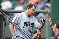 First baseman John Riley (38) of the Augusta GreenJackets is congratulated after hitting a home run  in a game against the Greenville Drive on Sunday, April 12, 2015, at Fluor Field at the West End in Greenville, South Carolina. Augusta won, 2-1. (Tom Priddy/Four Seam Images)
