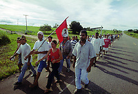 Members of Brazil's Landless Rural Workers' Movement (MST) walking for occupy  ranch at Belém-Brasilia Highway in Pará state northern of Brazil, on April 2001. The invasion is part of a celebration of reminding the massacre in which 19 MST members were killed by the police in Eldorado dos Carajas.