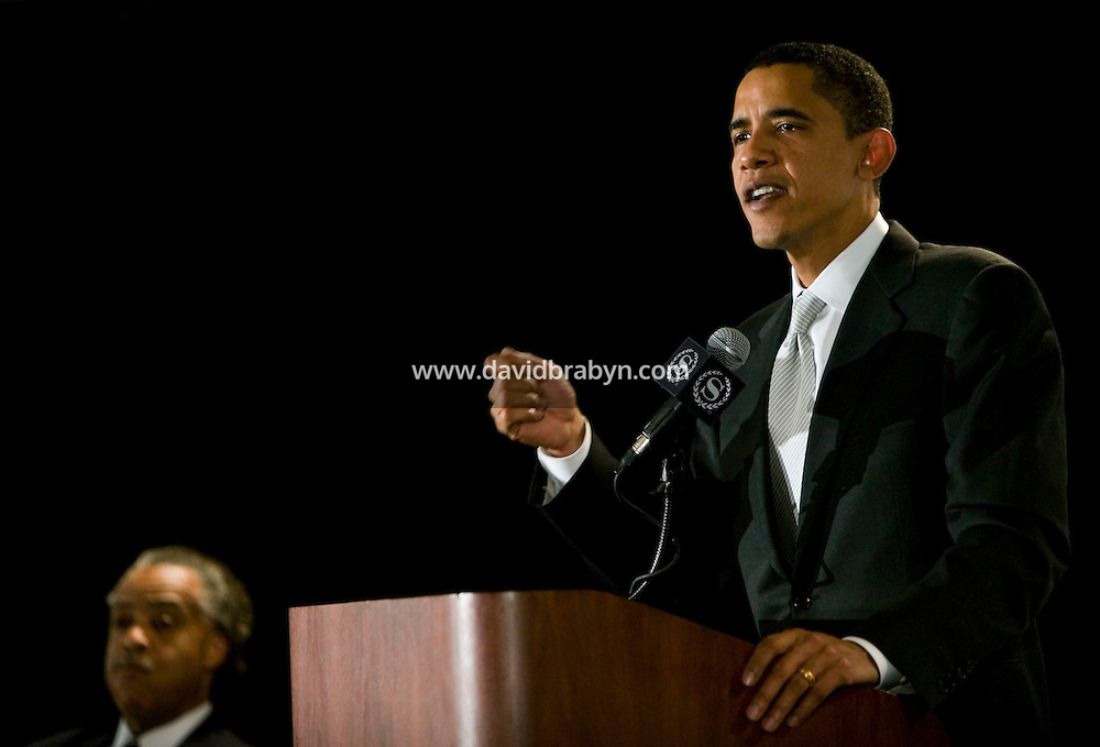 21 April 2007 - New York City, NY - Democratic presidential hopeful Senator Barack Obama (R) talks at the 9th Annual National Action Network Convention as the Reverend Al Sharpton listens in New York City, USA, April 2007.