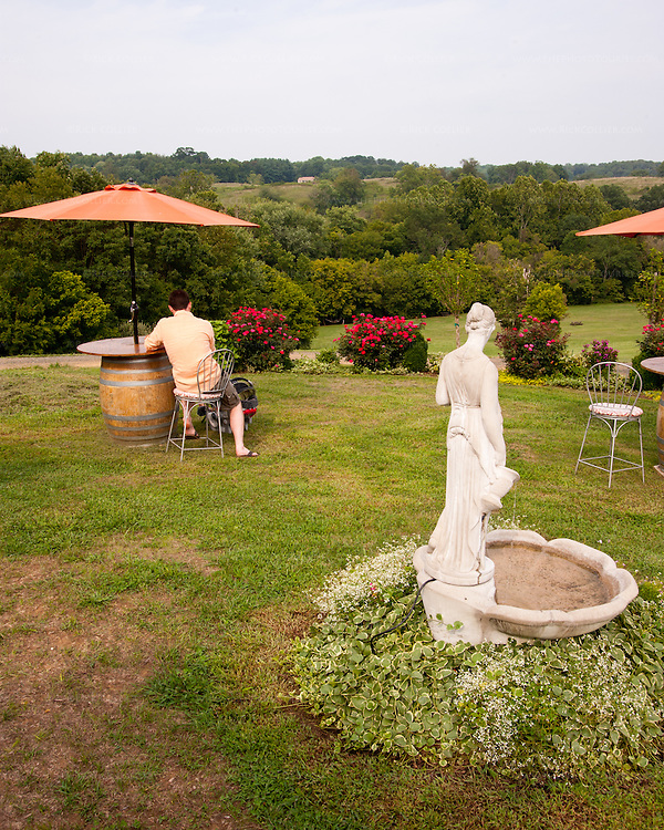 Among many seating areas around the property, Three Fox Vineyards also offers this lawn area with its fantastic view of the glade and hills beyond.