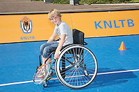 15-09-12, Netherlands, Amsterdam, Tennis, Daviscup Netherlands-Suisse, Boy in wheelchair with tennis racket