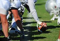 Sept. 16, 2009; Casa Grande, AZ, USA; Las Vegas Locomotives center prepares to hike the ball during training camp at the Casa Grande Training Facility & Performance Institute. Mandatory Credit: Mark J. Rebilas-