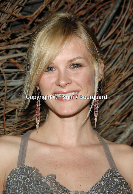 Bonnie Somerville  arriving at the Lubov Azria debut of the Panthera jewelry Collection at the Max Azria Boutique in Los Angeles.<br /> <br /> headshot<br /> eye contact<br /> smile