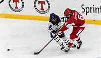 WORCESTER, MA - FEBRUARY 08: Nadia Mattivi #6 of Boston University takes a shot as Katie MacCuaig #6 of Holy Cross defends during a game between Boston University and College of the Holy Cross at Hart Center Rink on February 08, 2020 in Worcester, Massachusetts.