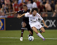 Alexandre Pato (7) of AC Milan tries to move past Jordan Graye (16) of D.C. United during a friendly at RFK Stadium in Washington, DC.  AC Milan lost to D.C. United, 3-2.