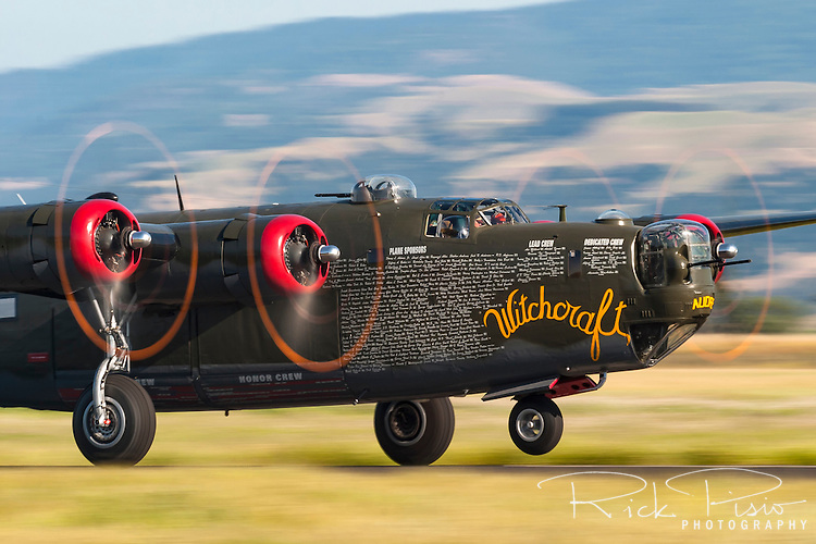 The Collings Foundation B-24 Liberator &quot;Witchcraft&quot; gets airborne while on a stop in Livermore, California. The Liberator was built in 1944 by Consolidated Aircraft in Fort Worth, Texas, and originally delivered to the US Army Air Forc. It was later transferred to the Royal Air Force and saw combat in the Pacific Theater. After the World War II the B-24 was abandoned by the British in Khanpur, India. In 1948 the Indian Air Force restored 36 B-24's to operational status and utilized them until 1968. <br /> <br /> The restoration of the B-24 was started in 1985 and involved complete disassembly of the plane and work on 80% of the Liberators 1.2 million parts. The work required overhaul or replacement of the entire hydraulic system as well as cables, hardware, and bearings. The overhaul also required replacement of over 420,000 rivets.<br /> <br /> In 2004 the Collings Foundation chose to honor the 8th Air Force and all who served in England as well as the European Theater of Operations by repainting the aircraft olive drab in the scheme of &quot;Witchcraft&quot; an aircraft assigned to the 467BG, 790BS that compiled an amazing record of 130 combat missions.