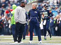 Head coach Mike Tomlin of the Pittsburgh Steelers talks with head coach Pete Carrol of the Seattle Seahawks during warm ups prior to the game at CenturyLink Field on November 29, 2015 in Seattle, Washington. (Photo by Jared Wickerham/DKPittsburghSports)