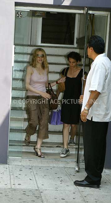 WWW.ACEPIXS.COM ** ** **EXCLUSIVE!!! FEE MUST BE NEGOTIATED BEFORE USE!!!**....NEW YORK, JUNE 9, 2005....Madonna heads to a downtown salon for a facial. Along the way she navigates a mud puddle and a locked door with an intercom.....Please byline: Philip Vaughan -- ACE PICTURES... *** ***  ..Ace Pictures, Inc:  ..Craig Ashby (212) 243-8787..e-mail: picturedesk@acepixs.com..web: http://www.acepixs.com
