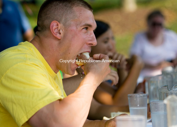SOUTHBURY, CT - 16 AUGUST 2009 -081609JT15-<br /> Southbury Police Officer Tony Renaldi puts away another hot dog during Sunday's hot dog eating contest at Leo's Restaurant in Southbury to benefit the Special Olympics of Connecticut. Renaldi won the contest, with a total of 17 hot dogs.<br /> Josalee Thrift Republican-American