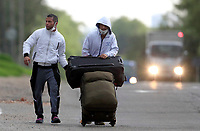 BOGOTA, COLOMBIA - April 13:  Immigrants from Venezuela walk on a local street as they head to their country due to COVID-19 pandemic on April 13, 2020 in Bogota, Colombia. COVID-19 pandemic has now at least 2 million cases worldwide and  1,864,629 people dead.  (Photo by Daniel Munoz/VIEWpress)