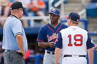 Kinston Indians manager Aaron Holbert #13 chats with umpire Tyler Wilson and Salem Red Sox manager Kevin Boles #19 at Lewis-Gale Field May 2, 2010, in Winston-Salem, North Carolina.  Photo by Brian Westerholt / Four Seam Images