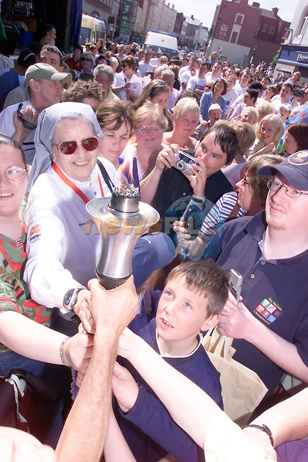 Sister Rosaleen McKenna holding the Olympic tourch during its visit to Drogheda.Photo Fran Caffrey/Newsfile.ie..This picture has been sent to you by:.Newsfile Ltd,.3 The View,.Millmount Abbey,.Drogheda,.Co Meath..Ireland..Tel: +353-41-9871240.Fax: +353-41-9871260.GSM: +353-86-2500958.ISDN: +353-41-9871010.IP: 193.120.102.198.www.newsfile.ie..email: pictures@newsfile.ie..This picture has been sent by Fran Caffrey.francaffrey@newsfile.ie