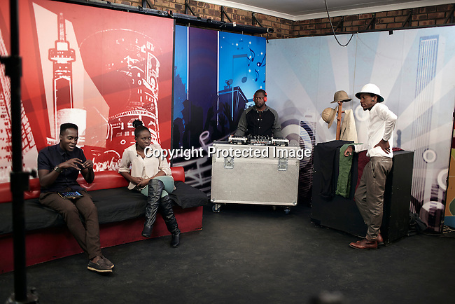 SOWETO, SOUTH AFRICA MAY 19: Floyd Avenue (r), a member of the Smarteez designer collective, talks about style during the taping of a show at Soweto TV on May 19, 2013 Orlando section Soweto, South Africa. He is a young designer and gets a chance to show his latest collection for a Television audience.  Soweto today is a mix of old housing and newly constructed townhouses. A new hungry black middle-class is growing steadily. Many residents work in Johannesburg but the last years many shopping malls have been built, and people are starting to spend their money in Soweto. (Photo by: Per-Anders Pettersson)