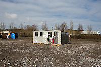 """The Adult School.<br /> <br /> Dunkirk Camp.<br /> <br /> Under the Sky of Calais & Dunkirk. Two Camps, Two Sides of the Same Coin: Not 'migrants', Not 'refugees', just Humans.<br /> <br /> France, 24-30/03/2016. Documenting (and following) Zekra and her experience in the two French camps at the gate of the United Kingdom: Calais' """"Jungle"""" and Dunkirk's """"Grande-Synthe"""". Zekra lives in London but she is originally from Basra in Iraq. Zekra and her family had to flee Kuwait - where they moved for working reason - due to the """"Gulf War"""", and to the Western Countries' will to """"export Democracy in Iraq"""". Zekra is a self-motivated volunteer and founder of """"Happy Ravers"""", a group of people (not a NGO or a charity) linked to each other because of their love for rave parties but also men and women who meet up every week to help homeless people and other people in need in Central London. (Here there are some of the stories I covered about Zekra and """"Happy Ravers"""": http://bit.ly/1XVj1Cg & http://bit.ly/24kcGQz & http://bit.ly/1TY0dPO). Zekra worked as an English teacher in the adult school at Dunkirk's """"Grande-Synthe"""" camp and as a cultural mediator and Arabic translator for two medic teams in Calais' """"Jungle"""". Please read her story at the beginning of this reportage."""