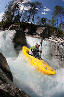 Kayak downhill race in the Brandseth river. The Extremesport Week, Ekstremsportveko, is the worlds largest gathering of adrenalin junkies. In the small town of Voss enthusiasts in a varitety of extreme sports come togheter every summer to compete and play. Norway.  ©Fredrik Naumann/Felix Features.