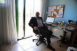 Stavros Agriotis, a Cypriot financial services executive, is seen in his home office in Nicosia, Cyprus on March 28, 2013.