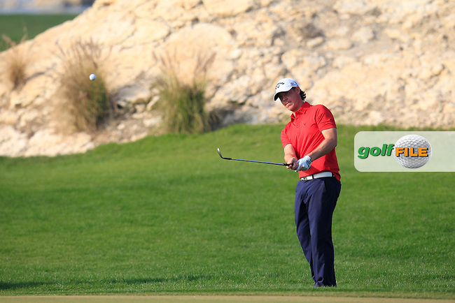 Kristoffer Broberg (SWE) chips onto the 16th green during Saturday's Final Round of the Commercial Bank Qatar Masters 2014 held at Doha Golf Club, Doha, Qatar. 25th January 2014.<br /> Picture: Eoin Clarke www.golffile.ie