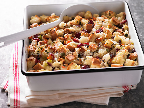 Stuffing in a large baking dish. Made with bread, dried cranberries, and herbs.