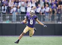 Dante Pettis changes direction on his way to a Pac-12 record 7th punt return for a touchdown.