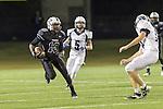 Cedar Ridge's Jalen Martin runs for yardage on a return against McNeil Thursday at Kelly Reeves Athletic Complex.  (LOURDES M SHOAF for Round Rock Leader)