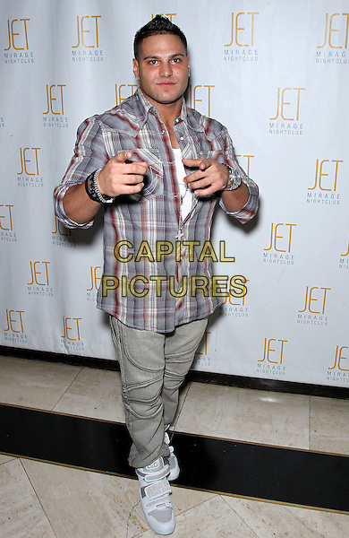 RONNIE MAGRO.Jersey Shore star Ronnie Magro celebrates his 24th birthday at Jet Nightclub inside the Mirage Resort Hotel and Casino, Las Vegas, Nevada, USA, 11th December 2010..full length hands gesture plaid shirt grey gray red trainers finger pointing .CAP/ADM/MJT.© MJT/AdMedia/Capital Pictures.