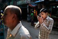 A Bangladeshi Hindu man pays in front of a Hindu temple by the side of a road early morning in Dhaka, Bangladesh.