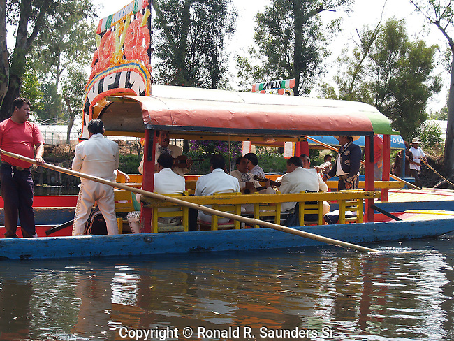 """[UNESCO WORLD HERITAGE SITE] (15)<br /> Xochimilco is one of the sixteen boroughs within Mexican Federal District. Today,the borough consists of eighteen neighborhoods along with fourteen villages that surround it. While the neighbhoods are somewhat in the geographic center of the Federal District, it is considered to be """"south"""" and has an identity separate from the historic center of Mexico City. Xochimilco is best known for its canals, which are left from what was an extensive lake and canal system that connected most of the settlements of the Valley of Mexico. These canals, along with artificial islands called chinampas, attract tourists and other city residents to ride on colorful gondolas called<br /> """"trajineras"""". Its Hispanic past, has made Xochimilco a World Heritage Site.ESCO WORLD HERITAGE SITE](15)"""