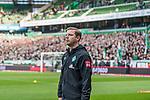 02.11.2019, wohninvest WESERSTADION, Bremen, GER, 1.FBL, Werder Bremen vs SC Freiburg<br /> <br /> DFL REGULATIONS PROHIBIT ANY USE OF PHOTOGRAPHS AS IMAGE SEQUENCES AND/OR QUASI-VIDEO.<br /> <br /> im Bild / picture shows<br /> Florian Kohfeldt (Trainer SV Werder Bremen), im Hintergrund Tribüne / Ostkurve / Fans, <br /> <br /> Foto © nordphoto / Ewert