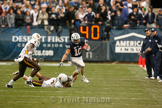 Trent Nelson  |  The Salt Lake Tribune.BYU running back JJ Di Luigi (10) is chased out of bounds by Wyoming's Tashaun Gipson (4) and Chris Prosinski (24) during the first half, BYU vs. Wyoming, college football Saturday, October 23, 2010 at LaVell Edwards Stadium in Provo.